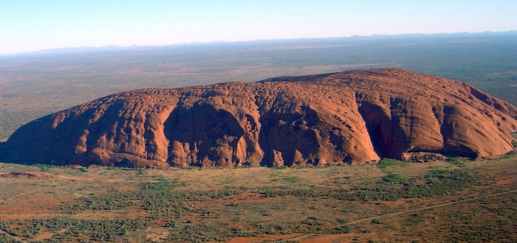 Image: Uluru rock in Central Australia. Indigenous Australians met in a historic summit overlooking it on May 24-26. Credit: Wikimedia Commons.