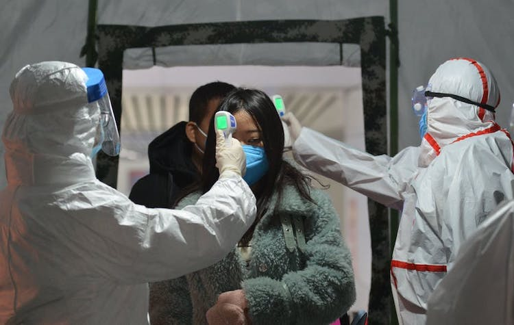 Photo: Body temperature being checked at the exit of a railway station in Fuyang, Anhui province, China, January 29, 2020. Credit: AN Ming/EPA