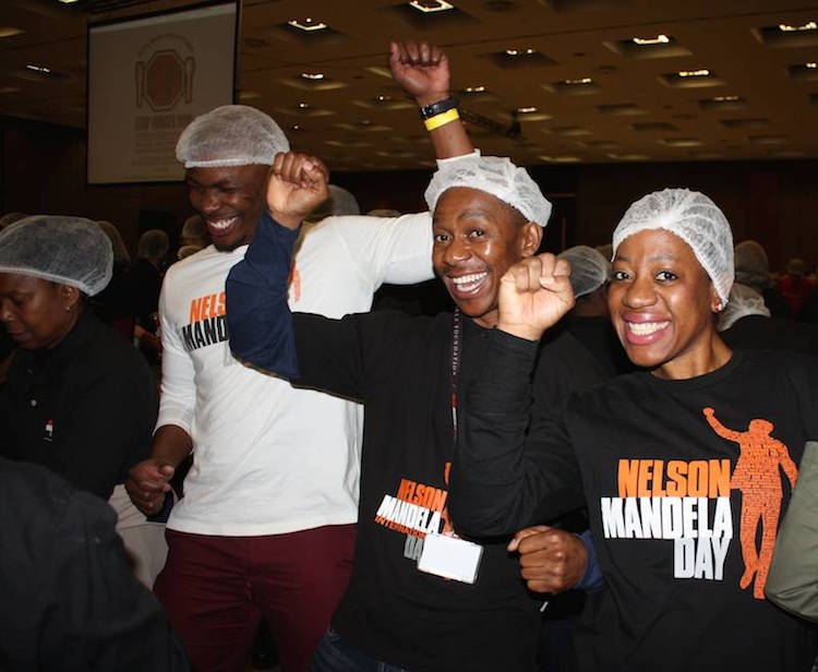 Photo: Smiling Nelson Mandela Foundation volunteers make the most of their 67 minutes for Mandela Day at the Sandton Convention Centre in Johannesburg. Credit: Nelson Mandela Foundation.