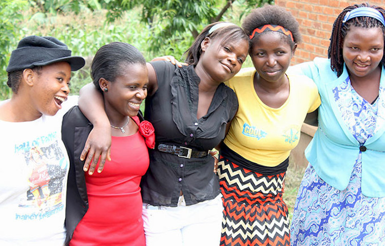 Photo: Girls from the Safeguard Young People programme in Malawi, which provides sexual and reproductive health information, helps young people access health services, and offers leadership training. Credit: UNFPA Malawi/Hope Ngwira.