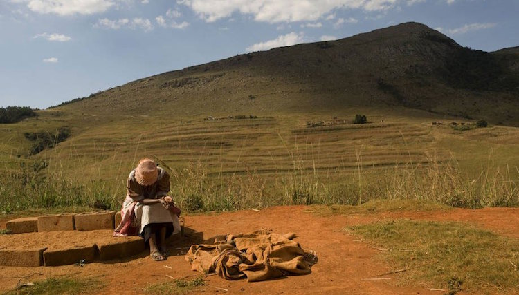 Photo: A farmer takes a break in Swaziland. Credit: FAO/Rodger Bosch