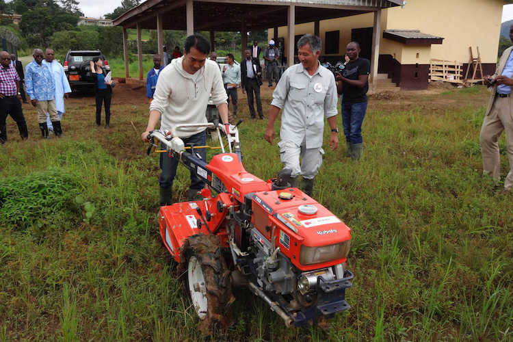 Photo: Japan's senior vice-minister of agriculture, forestry and fisheries Taku Eto tries out a Japanese-made tilling machine in Cameroon. Credit: The Government of Japan