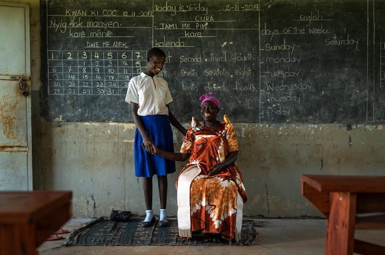 Photo: Margaret with one of her granddaughters. Credit: Brian Hodges for African Women Rising.