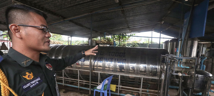 Photo: Colonel Channy Vongvannak, Commander of the Cambodian Force Military Police of UNMISS, inspects a water purification plant within the Cambodian quarters. Credit: UNMISS/Isaac Billy.