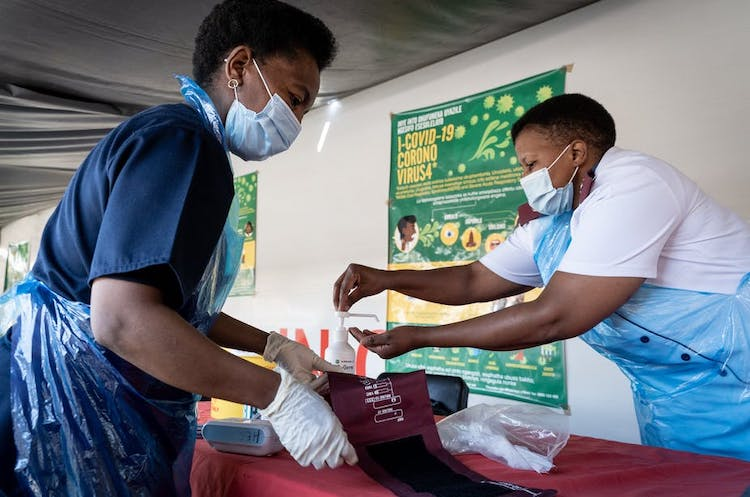 Photo: Nurses working in a South African COVID-19 clinic, based on a train, which travels to reach different communities. Credit: EPA-EFE