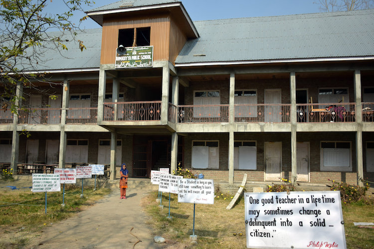 Photo: Placards, stressing the need of education and peace adorn the frontyard of a school run by the Ahmadiyya community in Reashinagar village in Shopian district of southern Kashmir (India). Credit: Stella Paul | IDN-INPS
