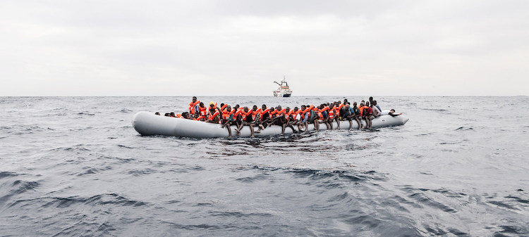Asylum-seekers and migrants aboard a dinghy in international waters off the coast of Libya in November 2016. UNHCR/Giuseppe Carotenuto