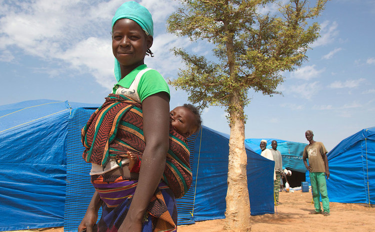 Photo: A mother and her baby at the IDP Pissila campsite in Burkina Faso. Credit: WFP/Marwa Awad