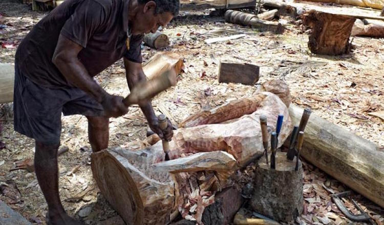 Photo: A wood carver in Solomon Islands. Credit: IUCN | Stuart Chape.